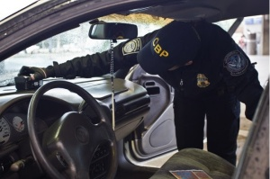 A CBP officer scans a car dashboard with a density meter in Arizona. Photo: Customs and Border Protection